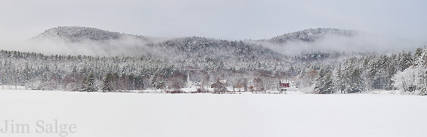 A wide shot of Eaton, New Hampshire over Crystal Lake, including the Little White Church.
