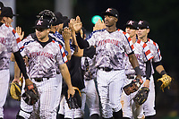 Micker Adolfo (27) of the Kannapolis Intimidators high fives his teammates following their win over the Hickory Crawdads in game two of a double-header at Kannapolis Intimidators Stadium on May 19, 2017 in Kannapolis, North Carolina.  The Intimidators defeated the Crawdads 9-1.  (Brian Westerholt/Four Seam Images)