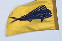 Mahi mahi fish flag blowing in the wind on a fishing boat at Honokahau Harbor in Kona