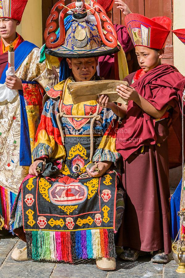 Nepal, Kathmandu, Swayambhunath.  Young Novice Monk Holds Sacred Text while Senior Monk Reads.