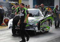 Mar. 9, 2012; Gainesville, FL, USA; NHRA crew chief Del Worsham prepares to guide funny car driver Alexis DeJoria into the staging beams during qualifying for the Gatornationals at Auto Plus Raceway at Gainesville. Mandatory Credit: Mark J. Rebilas-