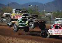 Apr 16, 2011; Surprise, AZ USA; LOORRS driver Casey Currie (2) and Kyle Leduc (99) during round 3 at Speedworld Off Road Park. Mandatory Credit: Mark J. Rebilas-.