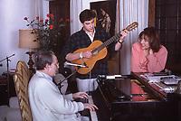 Domenico Modugno 25 anni dalla morte,  Domenico Modugno con La Moglie Franca Gandolfi e il figlio Marcello  Fotografato nella sua casa di Roma. 1987