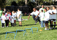 """High jumping participant during a  D.C United clinic in support of first lady Michelle Obama's """"Let's Move"""" initiative on the White House lawn, in Washington D.C. on October 7 2010."""