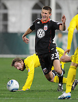 DC United defender Perry Kitchen (23) gets fouled by Columbus Crew midfielder Eddie Gaven (12)   DC United defeated The Columbus Crew 3-1  at the home season opener, at RFK Stadium, Saturday March 19, 2011.