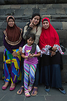 Borobudur, Java, Indonesia.  Indonesian Women Posing for their Photo.  Making the V sign is a common gesture in Indonesia when the person being photographed wants the photo to be a good one.