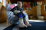 Vuntut Gwitchin First Nation elder Reverend Ellen Bruce with her caribou skin mitts and mukluks in her home Old Crow, Yukon Territory, Canada.