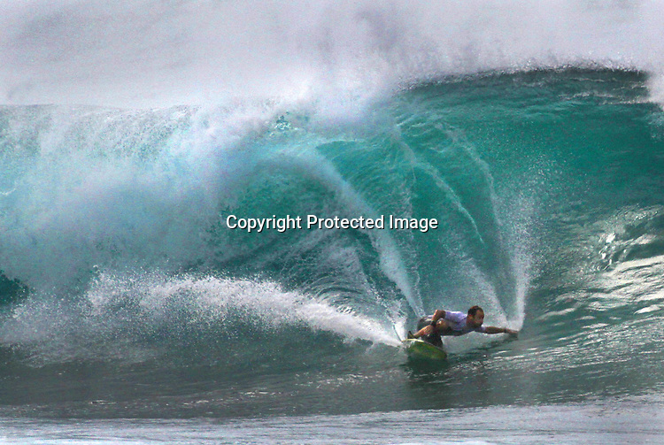 Surfing in on at Ehukai Beach (Banzai Pipeline) on the Northshore of Oahu, Hawaii. If there is such a thing as a perfect wave, you'll likely find it on Oahu's North Shore this seas0n. The big, glassy winter waves of this legendary surf mecca attract the best surfers in the world, while summer waves are far smaller and more gentle - all of which makes the North Shore the perfect surf spot for beginners and veterans alike..Stretching for more than 7 miles, the beaches of the