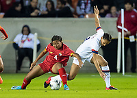 HOUSTON, TX - JANUARY 31: Hilary Jaen #4 of Panama and Lynn Williams #13 of the USA battle for the ball during a game between Panama and USWNT at BBVA Stadium on January 31, 2020 in Houston, Texas.