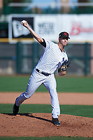Scottsdale Scorpions relief pitcher Cody Carroll (63), of the New York Yankees organization, delivers a pitch to the plate during an Arizona Fall League game against the Surprise Saguaros on October 27, 2017 at Scottsdale Stadium in Scottsdale, Arizona. The Scorpions defeated the Saguaros 6-5. (Zachary Lucy/Four Seam Images)
