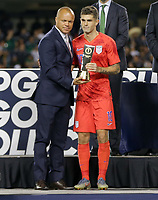 CHICAGO, ILLINOIS - JULY 07: Earnie Stewart awards Christian Pulisic #10 his trophy during the 2019 CONCACAF Gold Cup Final match between the United States and Mexico at Soldier Field on July 07, 2019 in Chicago, Illinois.