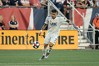 FOXBOROUGH, MA - AUGUST 3: Gustavo Bao #7 of New England Revolution in the midfield during a game between Los Angeles FC and New England Revolution at Gillette Stadium on August 3, 2019 in Foxborough, Massachusetts.