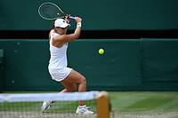 8th July 2021, Wimbledon, SW London, England; 2021 Wimbledon Championships, quarterfinals; Ashleigh Barty (Aus) returns to Angelique Kerber (Ger)