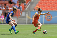 Houston, TX - Saturday May 27, 2017: Cari Roccaro (5) of the Houston Dash keeps the ball away from Beverly Yanez during a regular season National Women's Soccer League (NWSL) match between the Houston Dash and the Seattle Reign FC at BBVA Compass Stadium.
