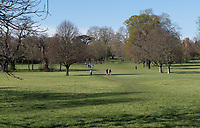 Quiet parkland as the public heed the rules as the weekend weather remains warm during the Covid-19 Pandemic in which the Government have given strict rules on only leaving the home for essential work, food shopping and one form of exercise per day.<br /> Sidcup, Kent on 5 April 2020. Photo by Alan  Stanford.