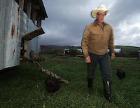 Farmer Joel Salatin opens the one of several doors to his mobile chicken coup allowing his chickens to graze in a new field October 20, 2006 at the Polyface Farm in Staunton, Va. ...Photo by Andrew B. Shurtleff, Freelance. farmer