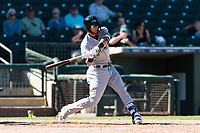 Peoria Javelinas first baseman Weston Wilson (18), of the Milwaukee Brewers organization, swings at a pitch during an Arizona Fall League game against the Surprise Saguaros at Surprise Stadium on October 17, 2018 in Surprise, Arizona. (Zachary Lucy/Four Seam Images)
