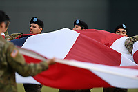 Soldiers from Columbia's Fort Jackson roll up a huge American flag following Opening Night ceremonies at the Columbia Fireflies game on Thursday, April 4, 2019, at Segra Park in Columbia, South Carolina. (Tom Priddy/Four Seam Images)