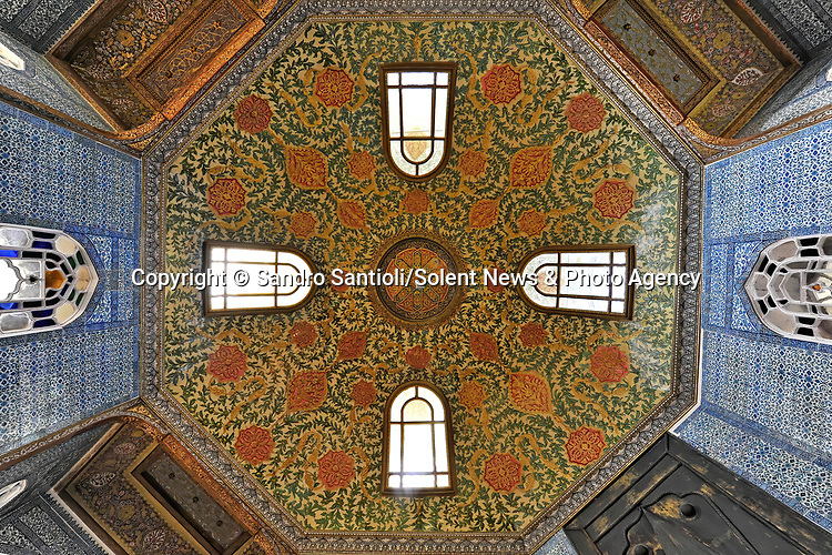 Pictured: Topkapi Palace Museum in Istanbul, Turkey. <br /> <br /> A series of photographs of ceilings from historic buildings show off kaleidoscopic patterns.  Italian photographer Sandro Santioli captured the mesmerising and intricately decorated interiors of some of Istanbul's grandest places of worship.<br /> <br /> The symmetry of the designs adorning ceilings in Topkapı Palace, Sultan Ahmed Mosque and Hagia Sophia Grand Mosque create kaleidoscopic patterns.  As well as Istanbul, Turkey, Mr Santioli photographed ceilings at the Amber Fortress in Jaipur, India.  SEE OUR COPY FOR DETAILS. <br /> <br /> Please byline: Sandro Santioli/Solent News<br /> <br /> © Sandro Santioli/Solent News & Photo Agency<br /> UK +44 (0) 2380 458800