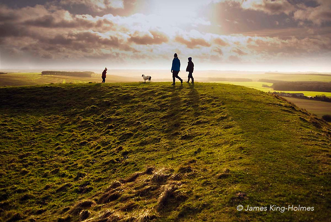 A New Year's Day walk along the perimeter bank enclosing the iron age hill fort known as Uffington Castle, topping the White Horse Hill at Uffington, Oxfordshire, UK. The fort is approximately 7.5 acres in area (approx 3 hectares).