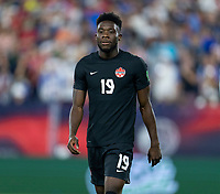 NASHVILLE, TN - SEPTEMBER 5: Alphonso Davies #19 of Canada looks to the ball during a game between Canada and USMNT at Nissan Stadium on September 5, 2021 in Nashville, Tennessee.