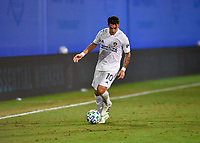LAKE BUENA VISTA, FL - JULY 18: Cristian Pavón #10 of LA Galaxy dribbles controls the ball during a game between Los Angeles Galaxy and Los Angeles FC at ESPN Wide World of Sports on July 18, 2020 in Lake Buena Vista, Florida.