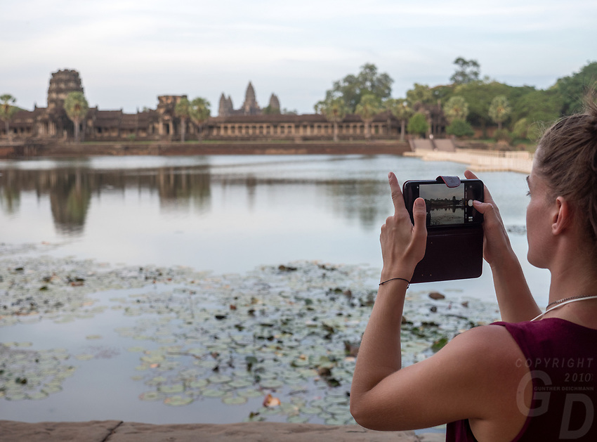 Tourists at Angkor Wat, Cambodia Tourist using their cell phones for selfies