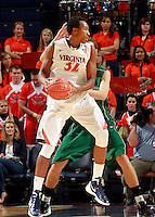 CHARLOTTESVILLE, VA- NOVEMBER 26:  Darion Atkins #32 of the Virginia Cavaliers handles the ball during the game on November 26, 2011 at the John Paul Jones Arena in Charlottesville, Virginia. Virginia defeated Green Bay 68-42. (Photo by Andrew Shurtleff/Getty Images) *** Local Caption *** Darion Atkins