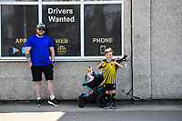 24th April 2021; Vicarage Road, Watford, Hertfordshire, England; English Football League Championship Football, Watford versus Millwall; A young family soak up the atmosphere around Vicarage Road before the game. With a win Watford could clinch promotion to the Premier League.