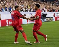 NASHVILLE, TN - JULY 3: Reggie Cannon #14 congratulates Weston Mckennie #8 after his goal during a game between Jamaica and USMNT at Nissan Stadium on July 3, 2019 in Nashville, Tennessee.