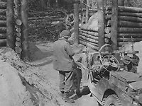 BNPS.co.uk (01202) 558833. <br /> Pic: Bosleys/BNPS<br /> <br /> Pictured: Laying charges to blow up a road block in Germany. <br /> <br /> Never before seen photos taken by a fishmonger turned SAS hero behind enemy lines in World War Two have come to light 76 years on.<br /> <br /> Sergeant Samuel Rushworth, of the 2nd Special Air Service, was dropped into occupied France two days before D-Day in June 1944.<br /> <br /> They were tasked with disrupting German reinforcements dispatched to Normandy following the Allied landings.