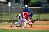 Canada Junior National Team third baseman Nathaniel Ochoa (29) fields a throw as Otto Lopez (11) slides in during an exhibition game against the Toronto Blue Jays on March 8, 2020 at Baseball City in St. Petersburg, Florida.  (Mike Janes/Four Seam Images)