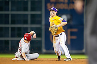 LSU Tigers shortstop Alex Bregman (8) turns a double play as Nebraska base runner Blake Headly (22) slides into second base during the Houston College Classic on March 8, 2015 at Minute Maid Park in Houston, Texas. LSU defeated Nebraska 4-2. (Andrew Woolley/Four Seam Images)