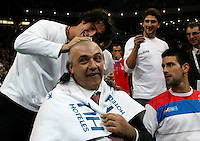 President of Serbia tennis federation left Ilija Bozoljac gets with Novak Djokovic right a celebratory haircut on the court right after the Serbian national tennis team won the Davis Cup finals against France in Belgrade, Serbia, Sunday, Dec. 5, 2010..(Srdjan Stevanovic/Starsportphoto ©)