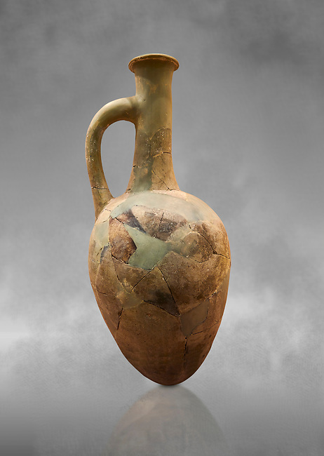 Hittite long neck pointed base terra cotta vessel. Hittite Old Period, 1650 - 1450 BC. Huseyindede. Çorum Archaeological Museum, Corum, Turkey. Against a grey bacground.