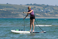 BNPS.co.uk (01202 558833)<br /> Pic: Graham Hunt/BNPS<br /> Date: 7th September 2021.<br /> <br /> A paddle boarder on the calm sea enjoying the scorching hot sunshine at the seaside resort of Weymouth in Dorset.