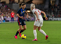 ORLANDO, FL - MARCH 05: Tobin Heath #17 of the United States dribbles towards Alex Greenwood #3 of England during a game between England and USWNT at Exploria Stadium on March 05, 2020 in Orlando, Florida.