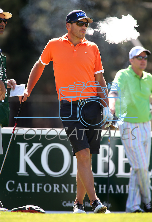Olympic gold medalist Bode Miller smokes a cigar during a practice round in the American Century Celeb-Am Tournament at Edgewood Tahoe in Stateline, Nev., on Thursday, July 18, 2013.<br /> Photo by Cathleen Allison