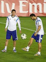 Lionel Messi of Argentina and Ezequiel Lavezzi during the training session