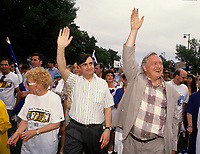 Montreal (Qc) CANADA,1995 File Photo <br /> Bloc Quebecois leader , Lucien Bouchard ( L) and<br /> Parti Quebecois  Leader Jacques Parizeau (R) wave at the crowd during the Saint Jean Baptiste parade, June 24, 1994 <br /> <br /> Photo by Pierre Roussel / Images Distribution