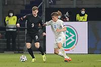 Timo Werner (Deutschland Germany) gegen Alsons Sampsted (Island Iceland) - 25.03.2021: WM-Qualifikationsspiel Deutschland gegen Island, Schauinsland Arena Duisburg