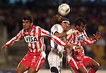 UNAM Pumas forward Bruno Marioni (C) heads the ball between Necaxa Rayos defenders Victor Gutierrez (L) and Rodolfo Espinoza during their soccer match at the Olympic Stadium in Mexico City, February 1, 2006. UNAM tied 0-0 to Necaxa. Photo by Heriberto Rodriguez