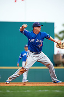 Toronto Blue Jays third baseman Matt Dominguez (32) throws to first during a Spring Training game against the Pittsburgh Pirates on March 3, 2016 at McKechnie Field in Bradenton, Florida.  Toronto defeated Pittsburgh 10-8.  (Mike Janes/Four Seam Images)