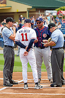 Hagerstown Suns manager Brian Daubach #23 and Rome Braves manager Matt Walbeck #11 meet at home plate with base umpire Shane Livensparger and home plate umpire Mike Cascioppo prior to the start of the game at State Mutual Stadium on May 1, 2011 in Rome, Georgia.   Photo by Brian Westerholt / Four Seam Images