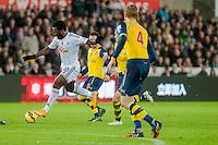 Sunday 9th November 2014<br /> Pictured: Wilfried Bony of Swansea City moves the ball forward surrounded by Arsenal players<br /> Re: Barclays Premier League Swansea City v Arsenal at the Liberty Stadium, Swansea, Wales,UK