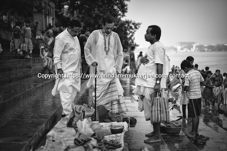 A man from a family with Zamindary(Landlord) past comes for a holy dip in the river Ganga on the occassion of Mahalaya. Kolkata, India.