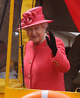 LIVERPOOL, ENGLAND - MAY 17: Queen Elizabeth II takes a ride on the Yellow Duck amphibious vehicle around Albert Dock during a visit to Merseyside Maritime Museum on May 17, 2012 in Liverpool, England. The Queen is visiting many parts of Britain as she celebrates her Diamond Jubilee culminating with a four-day public holiday on June 2-5, including a pageant of 1,000 boats on the River Thames.<br /> <br /> People:  Queen Elizabeth II
