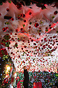 """30/11/15<br /> <br /> Waitress, Alice Marchington, 18, puts up the last decorations in the 'Candy Cain' room.<br /> <br /> It has taken a team of five, two weeks to put up this stunning display of Christmas decorations in what is believed to be one of Britain's most festive pubs. The race was on to put up the 7,500 baubles and 27,000 fairy lights, before guests arrived for the pub's first Christmas parties held last night. <br /> <br /> Each of the five rooms at the Hanging Gate at Chapel-en-le-Frith in the Derbyshire Peak District has a different theme or colour. This year the main restaurant is the Indoor Igloo, the bar area is purple and gold and there's the Candy Cain room upstairs in the pub near Buxton. There's also has another 10,000 lights on the outside of the building. <br /> <br /> """"We've had to replace a few thousand of the LED lights this year, I buy them in huge lengths so it's cost lots  to get everything ready"""" said landlord Mark Thomas.<br /> <br /> All Rights Reserved: F Stop Press Ltd. +44(0)1335 418365   www.fstoppress.com."""