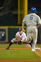 First baseman Jimmy Comerota #2 of the Rice Owls waist for the throw as Cody Decker #6 of the UCLA Bruins hustles down the first base line in the 2009 Houston College Classic at Minute Maid Park February 27, 2009 in Houston, TX.  The Owls defeated the Bruins 5-4 in 10 innings. (Photo by Brian Westerholt / Four Seam Images)