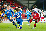 St Johnstone v Inverness Caledonian Thistle.....25.04.11.Aaron Doran scores the second goal.Picture by Graeme Hart..Copyright Perthshire Picture Agency.Tel: 01738 623350  Mobile: 07990 594431